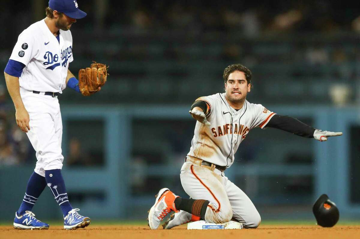 LOS ANGELES, CALIFORNIA - JUNE 28: Mike Tauchman #29 of the San Francisco Giants argues the call against him as he is tagged out by Chris Taylor #3 of the Los Angeles Dodgers at second base in the ninth inning at Dodger Stadium on June 28, 2021 in Los Angeles, California. (Photo by Meg Oliphant/Getty Images)