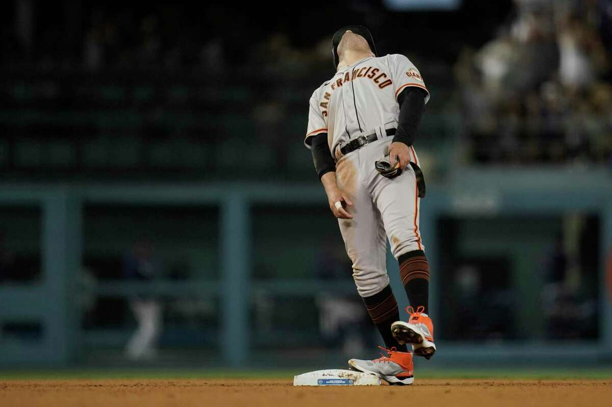 San Francisco Giants' Mike Tauchman reacts after a video review confirmed that he was tagged out by Los Angeles Dodgers' Chris Taylor at second base while trying to take the base on a single during the ninth inning of a baseball game, Monday, June 28, 2021, in Los Angeles. (AP Photo/Jae C. Hong)
