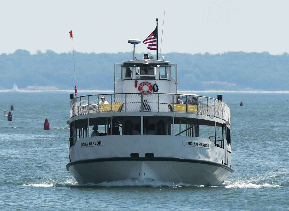 The Island Beach Ferry passes through Greenwich Harbor to dock in June 2020. Ferry service will be suspended to Great Captain Island over the long holiday weekend.