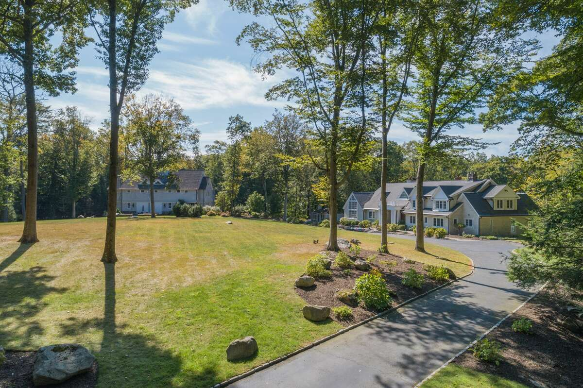 """The 364 Laurel Road home in New Canaan, Conn. has a main house with over 9,200 square feet of living space, as well as a 15,000-square-foot """"sports barn"""" that has its own movie theater, basketball court and recreation area."""