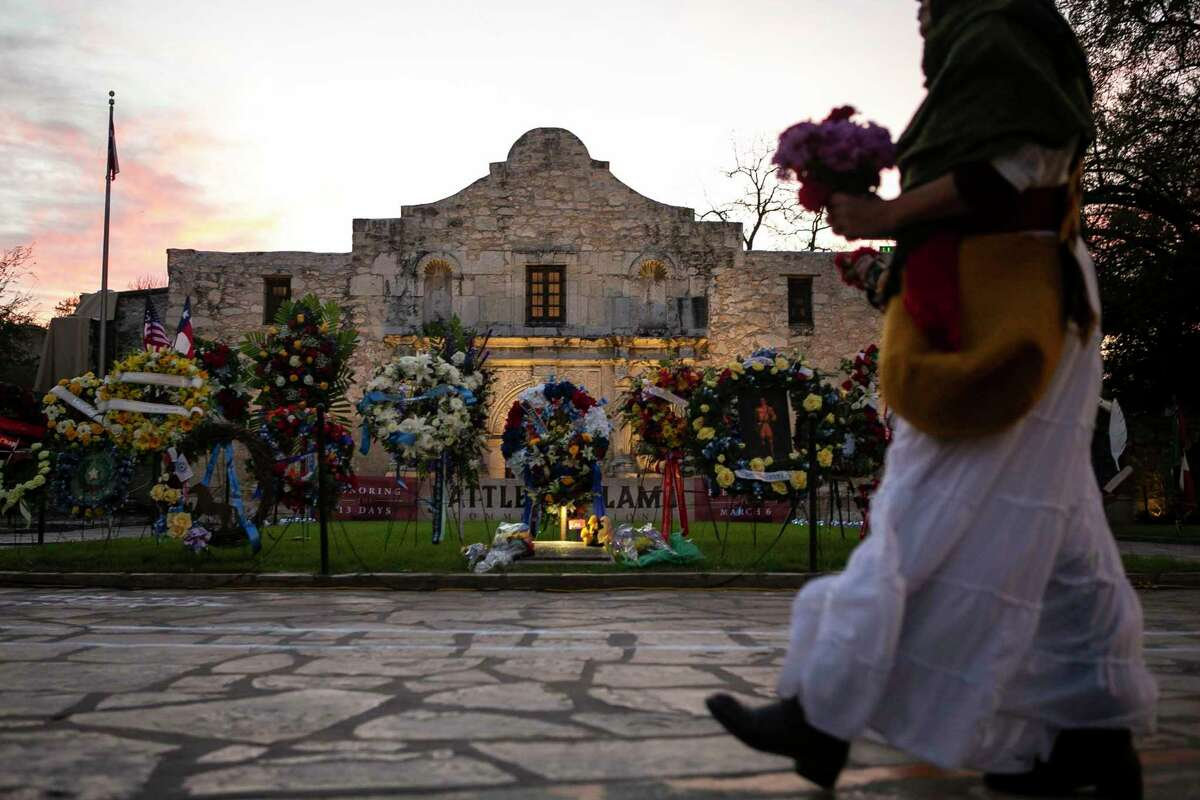 """Wreaths adorn the lawn of the Alamo during the """"Dawn at the Alamo"""" ceremony commemorating the anniversary of the Battle of the Alamo on March 6, 2020. Although the state-owned mission and battle site is seen as place to remember those who lived and died there, leaders of two descendants' groups are questioning the site's policy allowing placement of cremated human remains in gardens at the complex."""