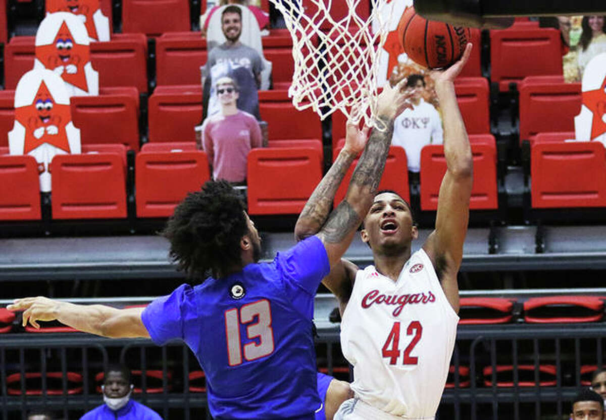 Shamar Wright (42) of Southern Illinois University Edwardsville scores over Tennessee State's Mason Green during a Feb. 4 home game. Starting Thursday, Illinois student-athletes can sign individual endorsement deals while enrolled at a college or university.
