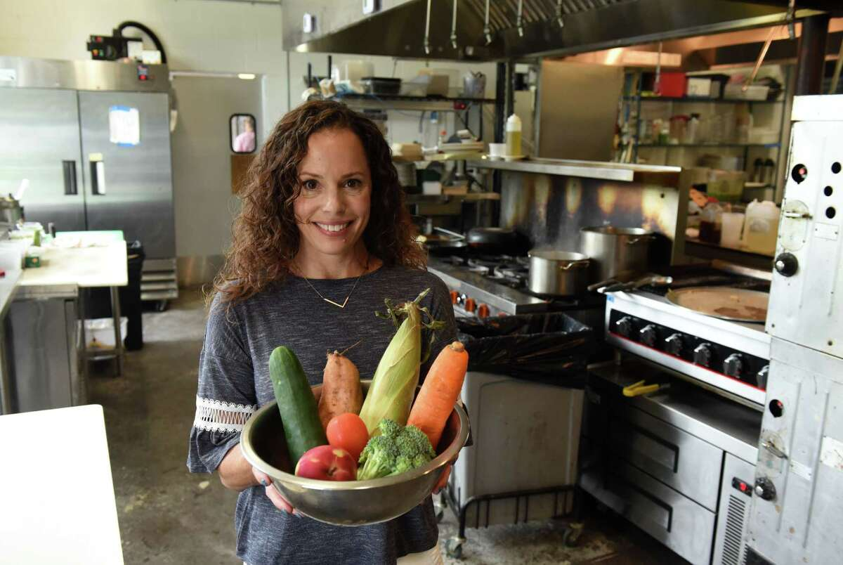 Dr. Jennifer Lefner, founder of Seedlings Baby Food, holds a bowl of the type of fresh vegetables she uses in her products in the kitchen of 9 Miles East in Saratoga Springs.(Will Waldron/Times Union)