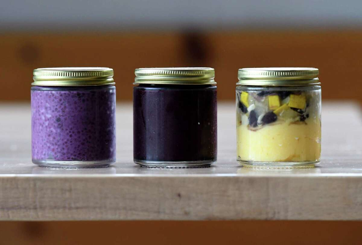 Jars of Seedlings Baby Food include, from left, blueberry chia pudding, blueberry, and lime-scented black bean and polenta with summer squash.