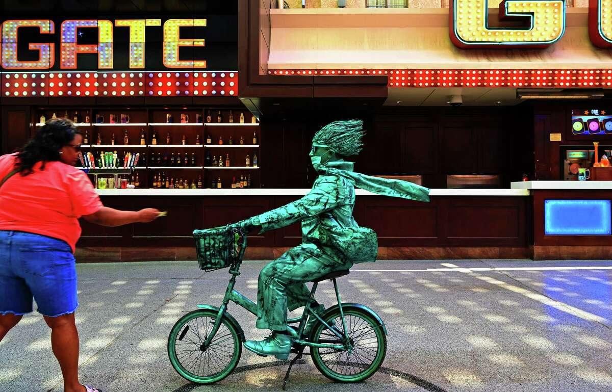 A tourist encounters a living statue in Las Vegas.
