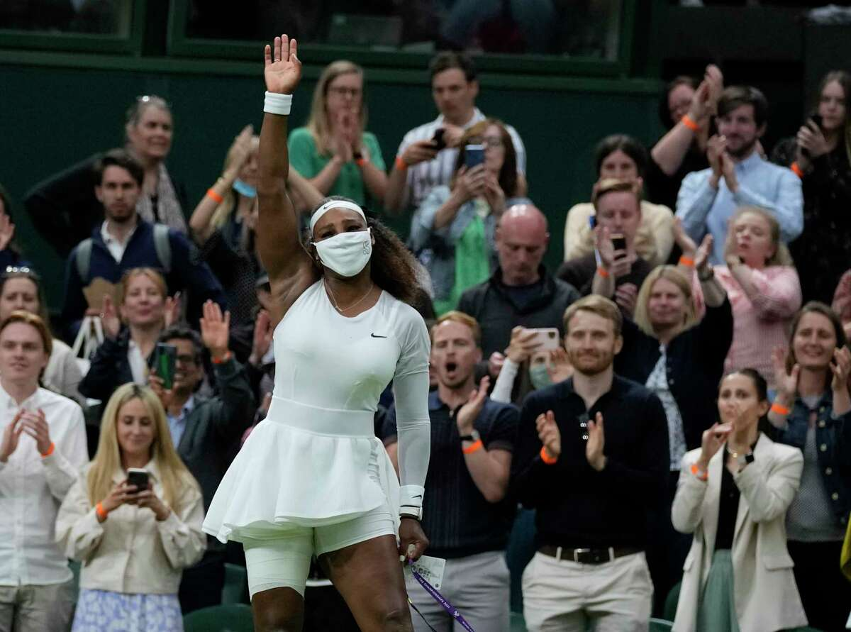 Serena Williams waves as she leaves the court after retiring from the women's singles first round match Tuesday against Aliaksandra Sasnovich of Belarus on day two of the Wimbledon Tennis Championships in London.
