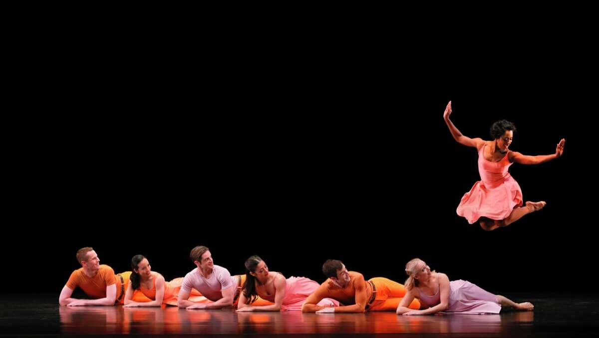 """Michelle Fleet (jumping) with (left to right) Lee Duveneck, Madelyn Ho, Michael Apuzzo, Parisa Khobdeh, Robert Kleinendorst and Jamie Rae Walker in Paul Taylor Dance Company's """"Esplanade."""" (credit: Paul B. Goode)"""