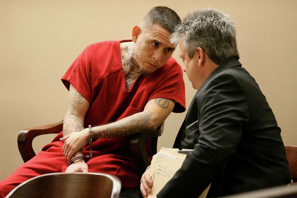 Christopher Davila, left, 34, talks with defense attorney Bob Behrens during a court appearance in 2019. Davila was accused of falsely reporting a kidnapping to mislead investigators, but he later told them where his 8-month-old boy, King Jay Davila, was buried, and said the death was an accident. On Tuesday, he pleaded no contest to a charge of injury to a child and was sentenced to 40 years in prison.