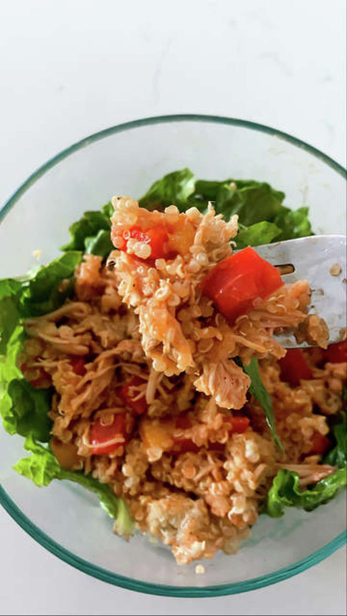 Buffalo Chicken and Veggies with Quinoa dish is perfect for meal prepping, according to recipe creator Rachel Tritsch.
