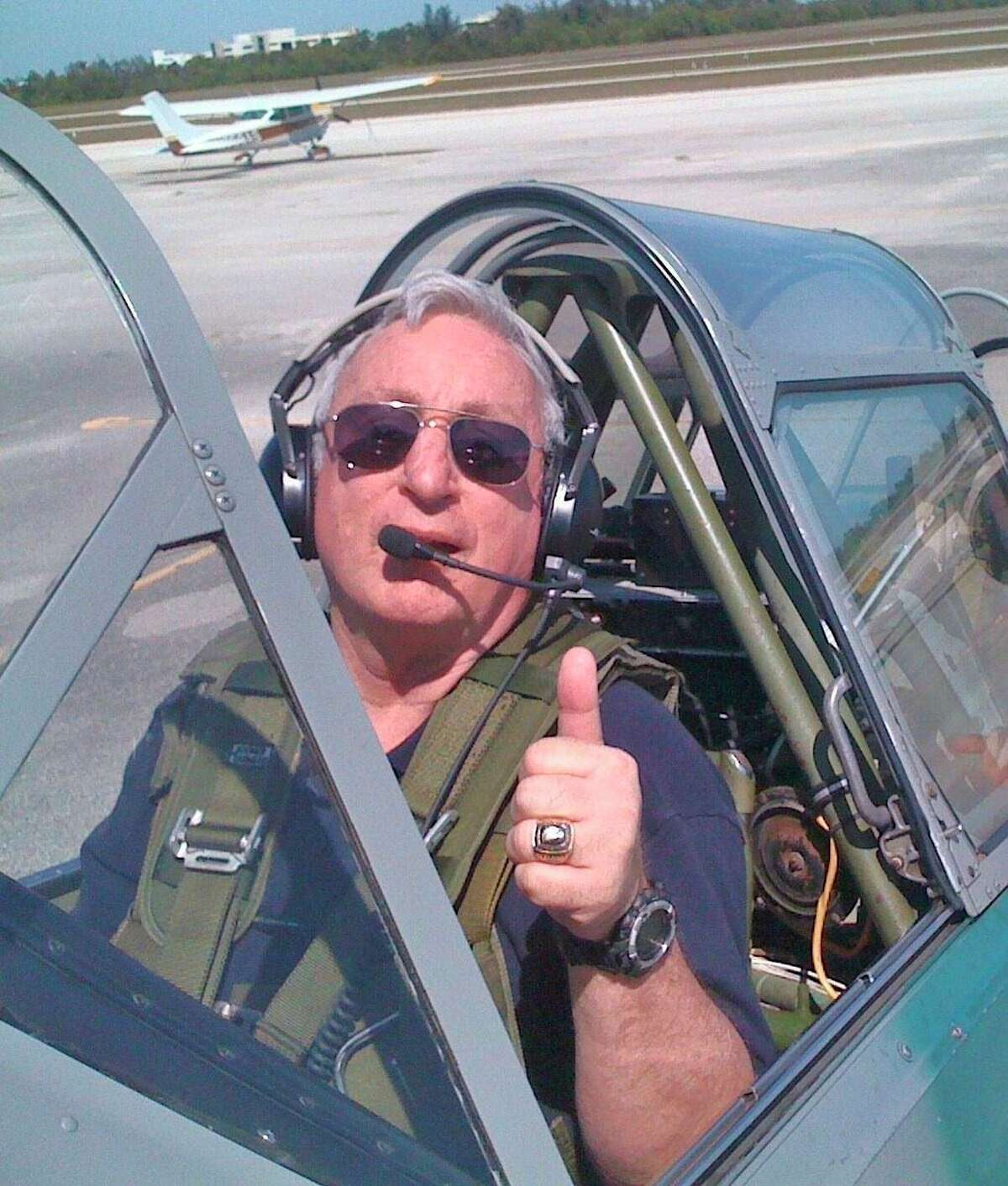 """William """"Billy"""" Rands gives a thumbs up from the cockpit of anairplane. Rands was an avid and licensed commercial pilot, who loved flying around the Thumb. (Courtesy Photo)"""
