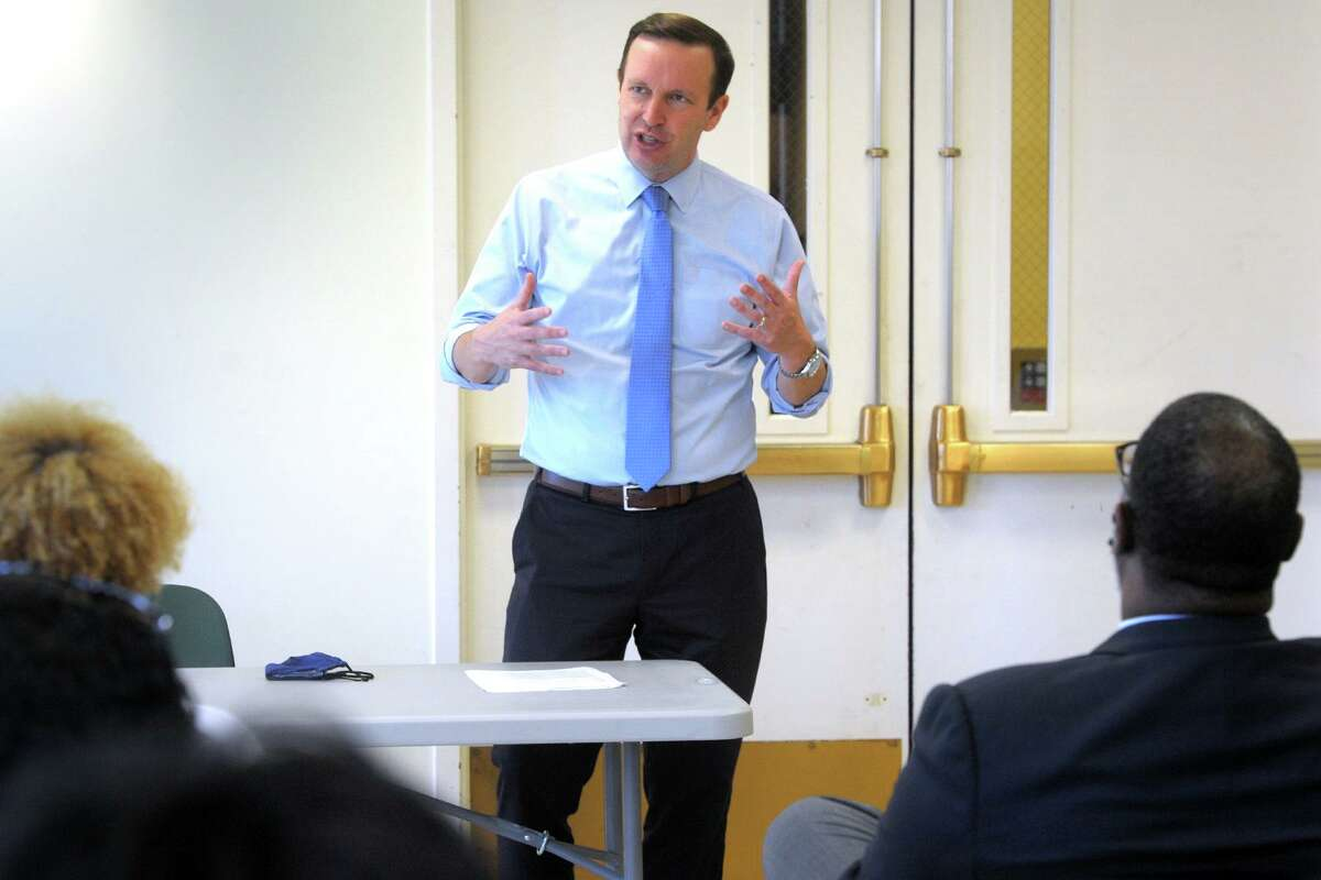 U.S. Sen. Chris Murphy leads a meeting with small business owners in Bridgeport, Conn. June 29, 2021.