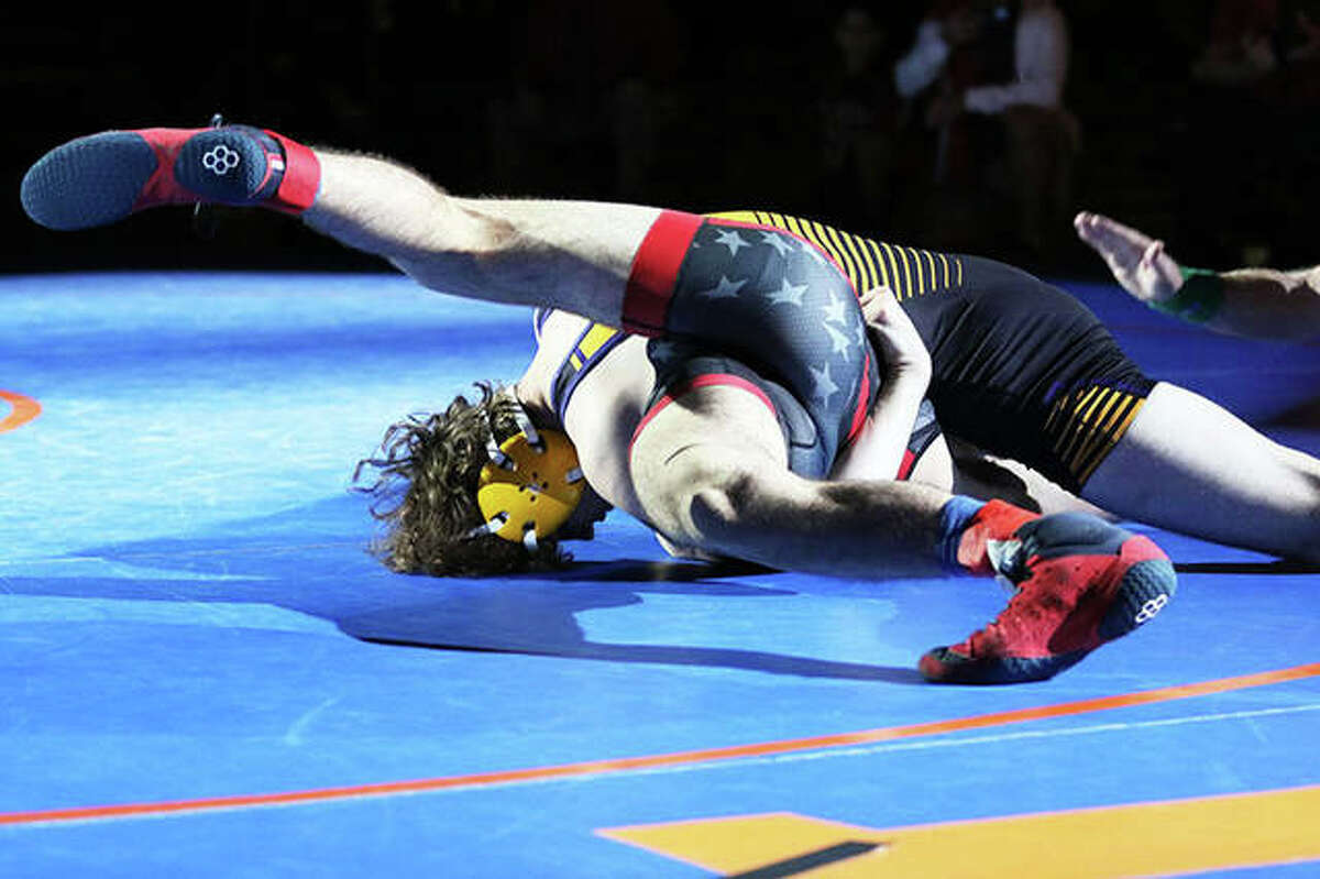 CM senior Vinny Zerban (top) pins Deerfield's Ben Shvartsman just 48 seconds into the first period of their 152-pound championship match Friday at the IWCOA Class 2A wrestling state meet in Springfield. Zerban finished the season 28-0.