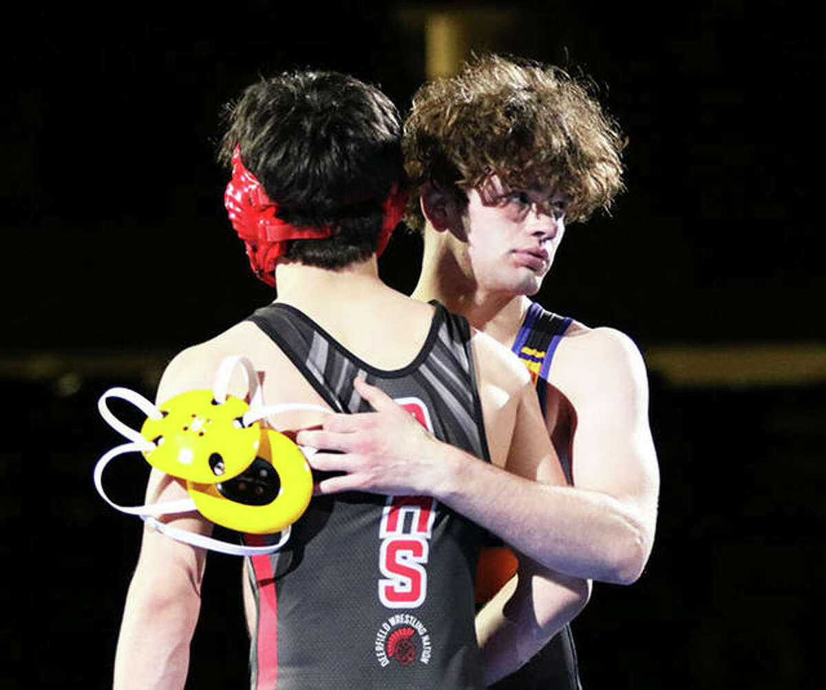 CM's Vinny Zerban (right) shakes hands with Deerfield's Ben Shvartsman after Zerban's win by fall in their 152-pound title bout at the Class 2A state meet Friday in Springfield.