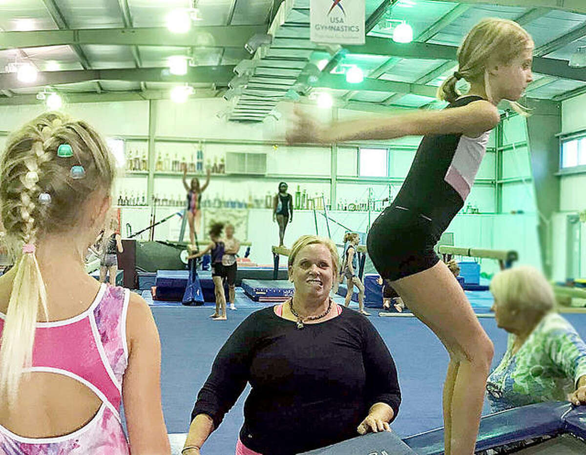 Coach Kristin Bower works with young gymnasts at Mid-Illinois Gymnastics in Godfrey. Bower said numbers at the gym are increasing following the pandemic and that interest has gone up as a result of the popularity of the US Olympic Gymnastics Trials and the upcoming Tokyo Summer Olympic Games.