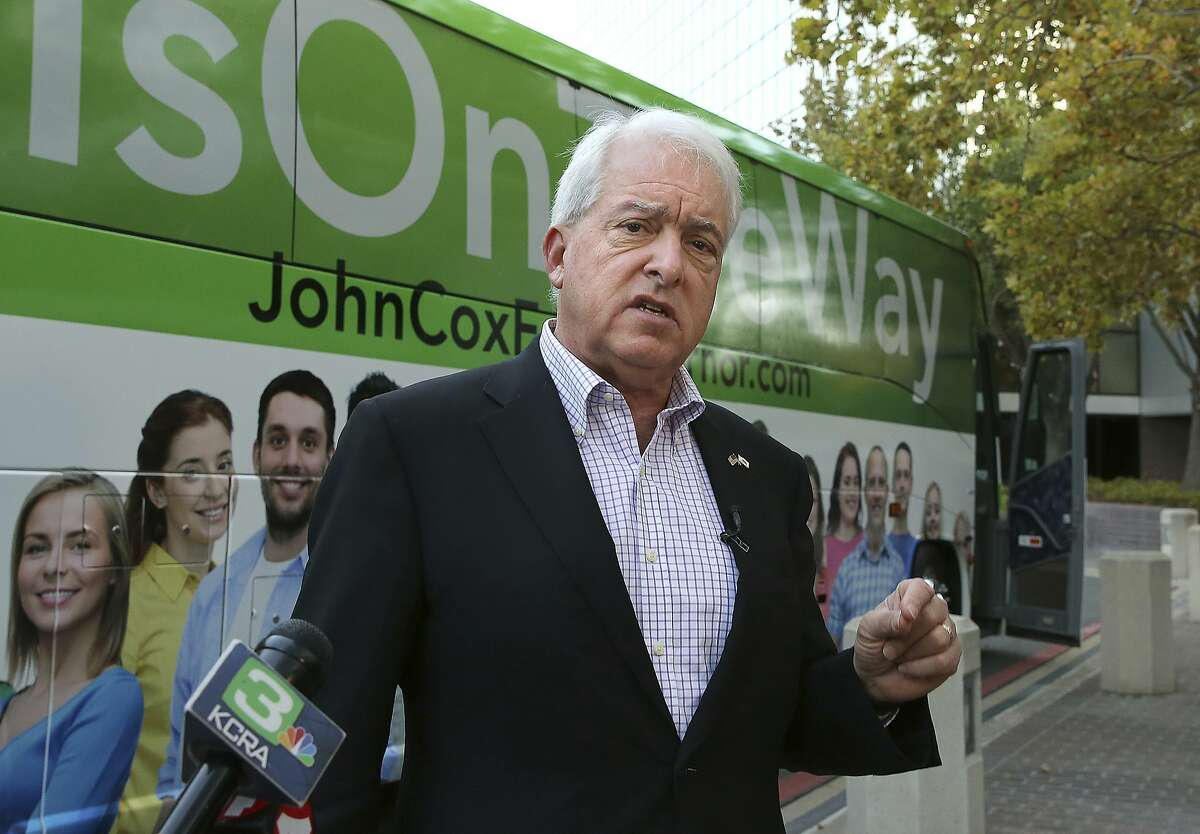 Republican gubernatorial candidate John Cox talks to reporters on Nov. 1, 2018 before beginning a statewide bus tour in Sacramento, Calif. during his run for governor against Gavin Newsom.