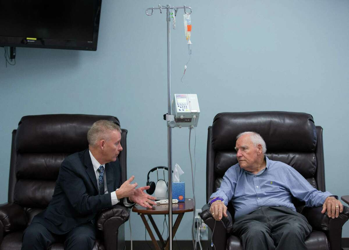 UTHealth neurologist Dr. Paul Schulz, left, talks with his patient Rolfe Johnson, who was receiving the first infusion of Aducanumab - an Alzheimer's drug recently approved by the FDA - in the state of Texas, on Wednesday, June 23, 2021, in Houston. Johnson was diagnosed with Alzheimer's five years ago.
