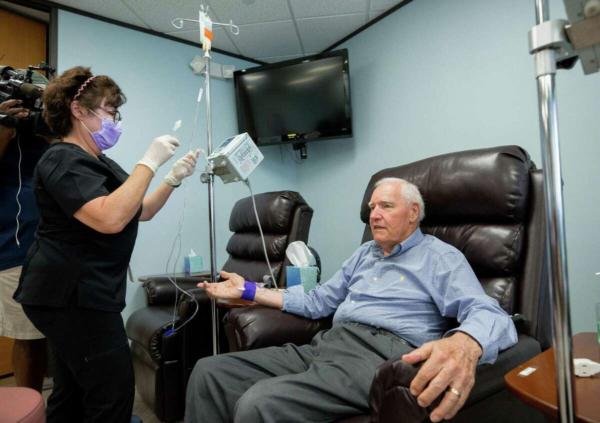 Rolfe Johnson receives the first infusion of an Alzheimer's drug recently approved by the FDA.