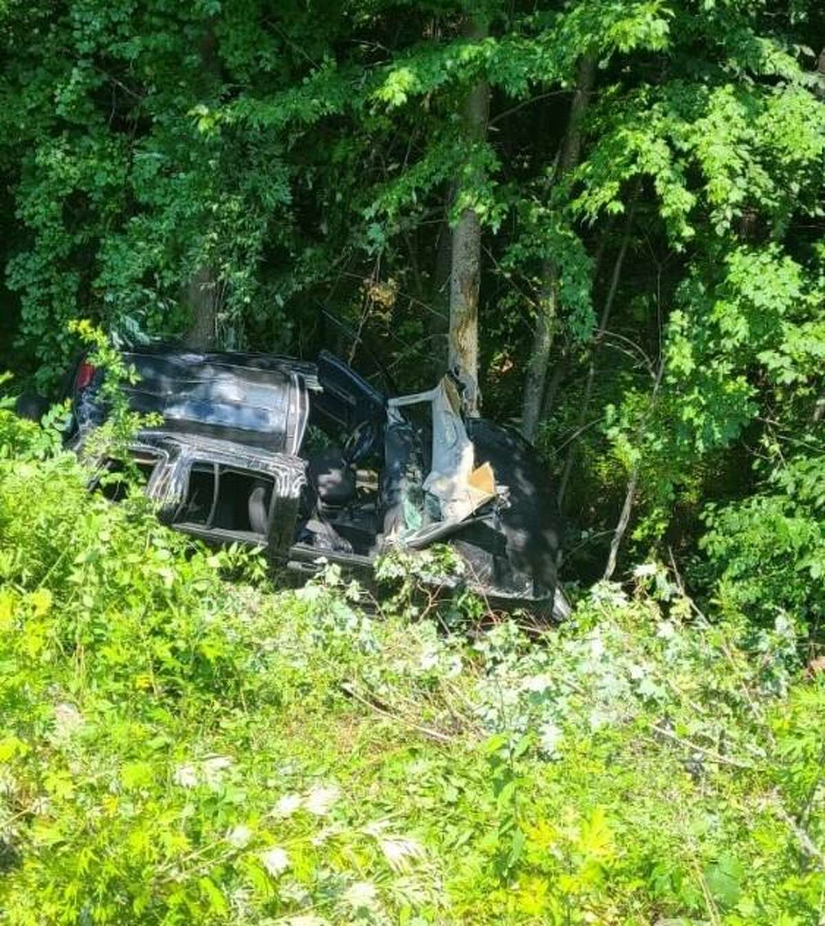 Shelton first responders are on scene for a rollover down a 30-foot embankment with extrication needed on Route 8 north on Tuesday, June 30, 2021.