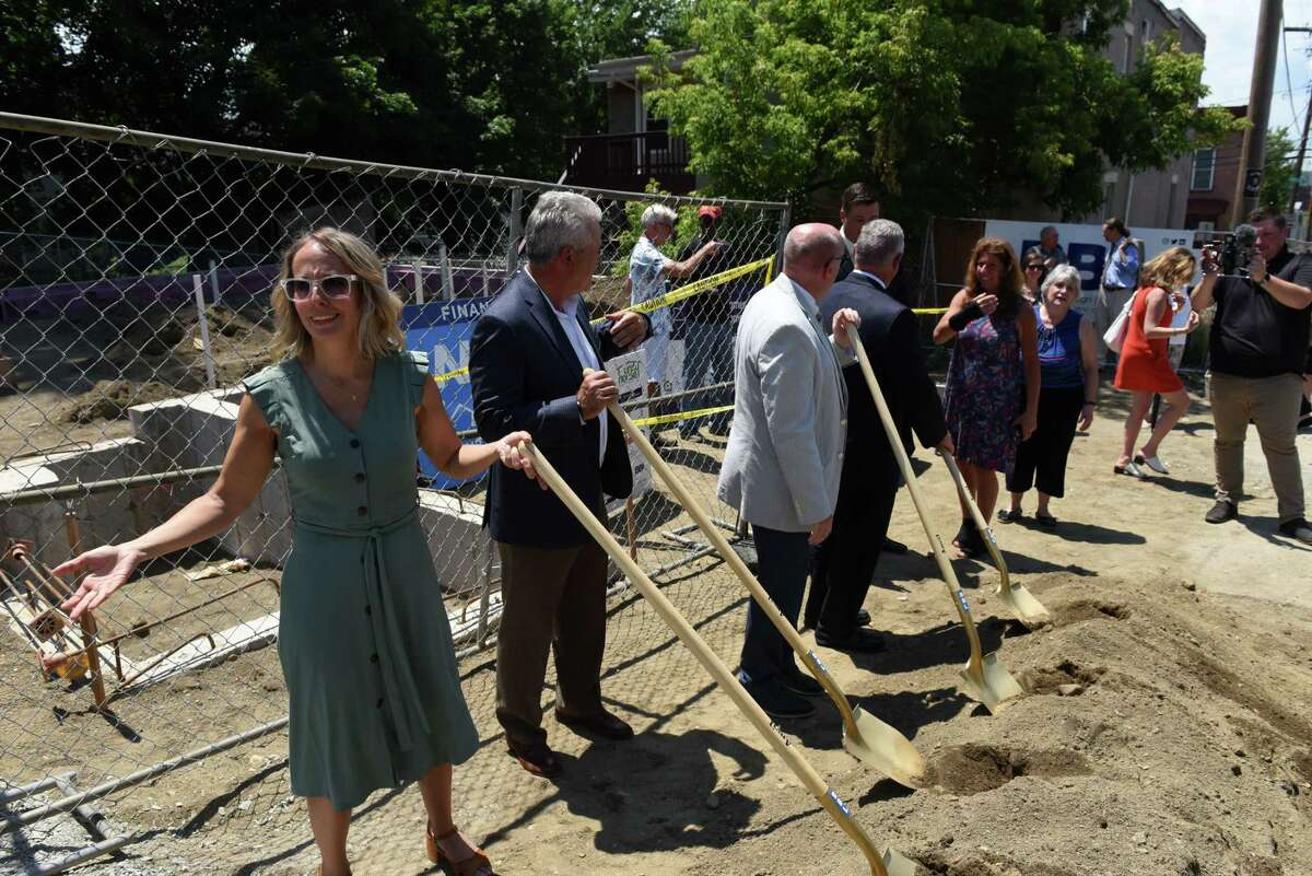 Troy Rehabilitation and Improvement Program President Christine Nealon, left, joins local dignitaries in breaking ground for the Hillside Views Neighborhood Revitalization housing program on Tuesday, June 29, 2021, outside one of the new properties on Rensselaer Street in Troy, N.Y. The housing development will consist of 51 apartments in several locations for individuals and families with 26 households to receive supportive services through Unity House. (Will Waldron/Times Union)