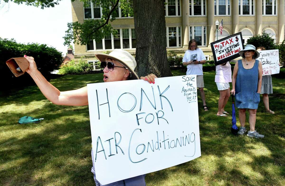 Christi Papa (left) of Wallingford protests in front of Wallingford Town Hall for air conditioning in the kennel area of the Shirley Gianotti Municipal Animal Shelter on June 29, 2021.