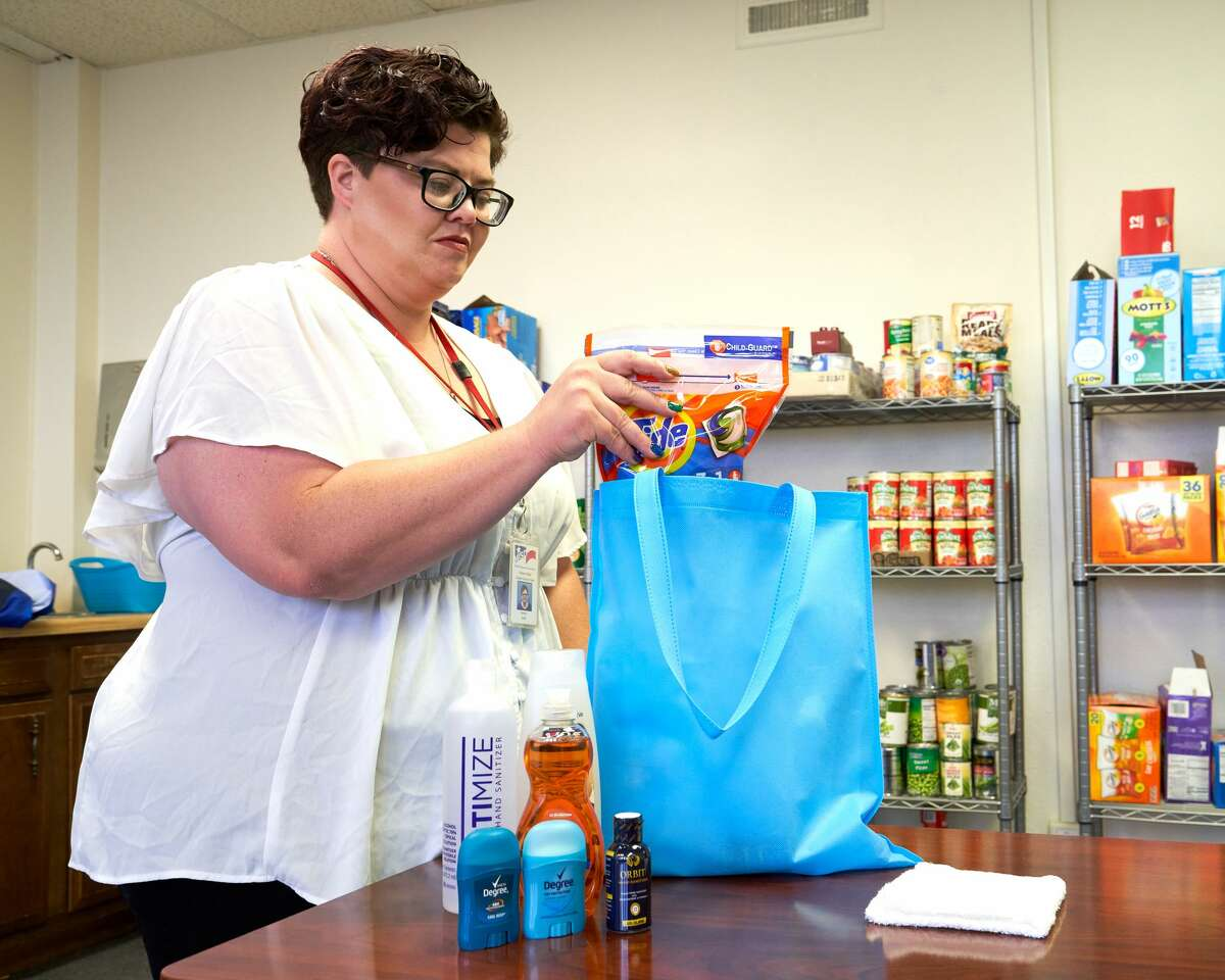 Family Support Specialist Chalace Phillips fills a hygiene bag at the Midland ISD Family Support Center on June 22. Bags like these are given to homeless students as part of the Family Support Center's homeless student outreach program. TREVOR HAWES/MIDLAND ISD