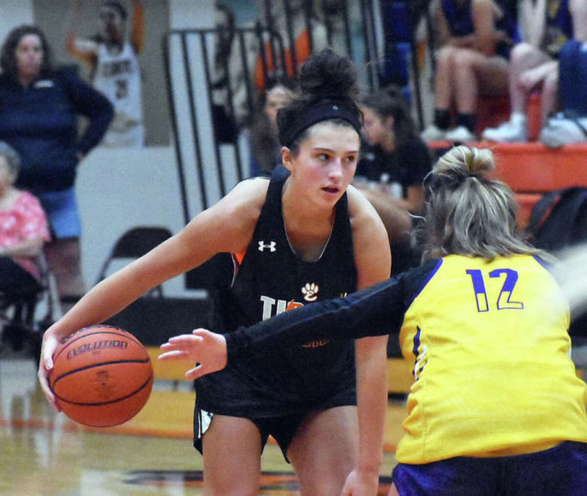 Edwardsville guard Macy Silvey runs the offense at the top of the arc during a scrimmage against Civic Memorial on Tuesday inside Lucco-Jackson Gymnasium.