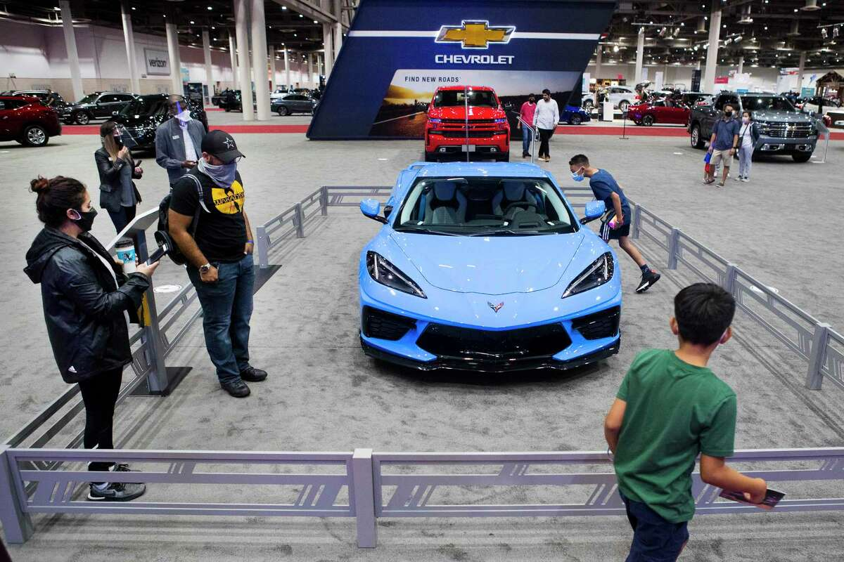Visitors to the Houston Summer Auto Show check out a Corvette as they walk through the Chevrolet booth at NRG Center Wednesday, May 19, 2021 in Houston. The 38th Houston Auto Show, the first auto show in Texas since the pandemic, presents a collection of manufacturers vehicles with the from the automotive world. The event continues to allow attendees to see, touch, drive and experience the industries newest offerings on wheels.