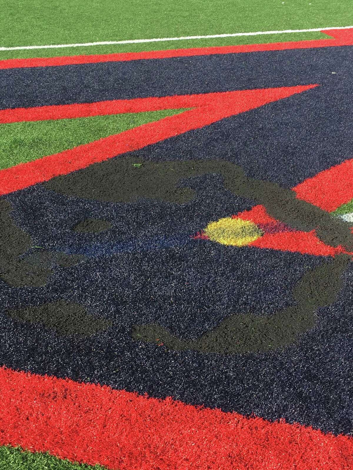 Scorch marks left by an illegal firework set off at Brien McMahon High School.