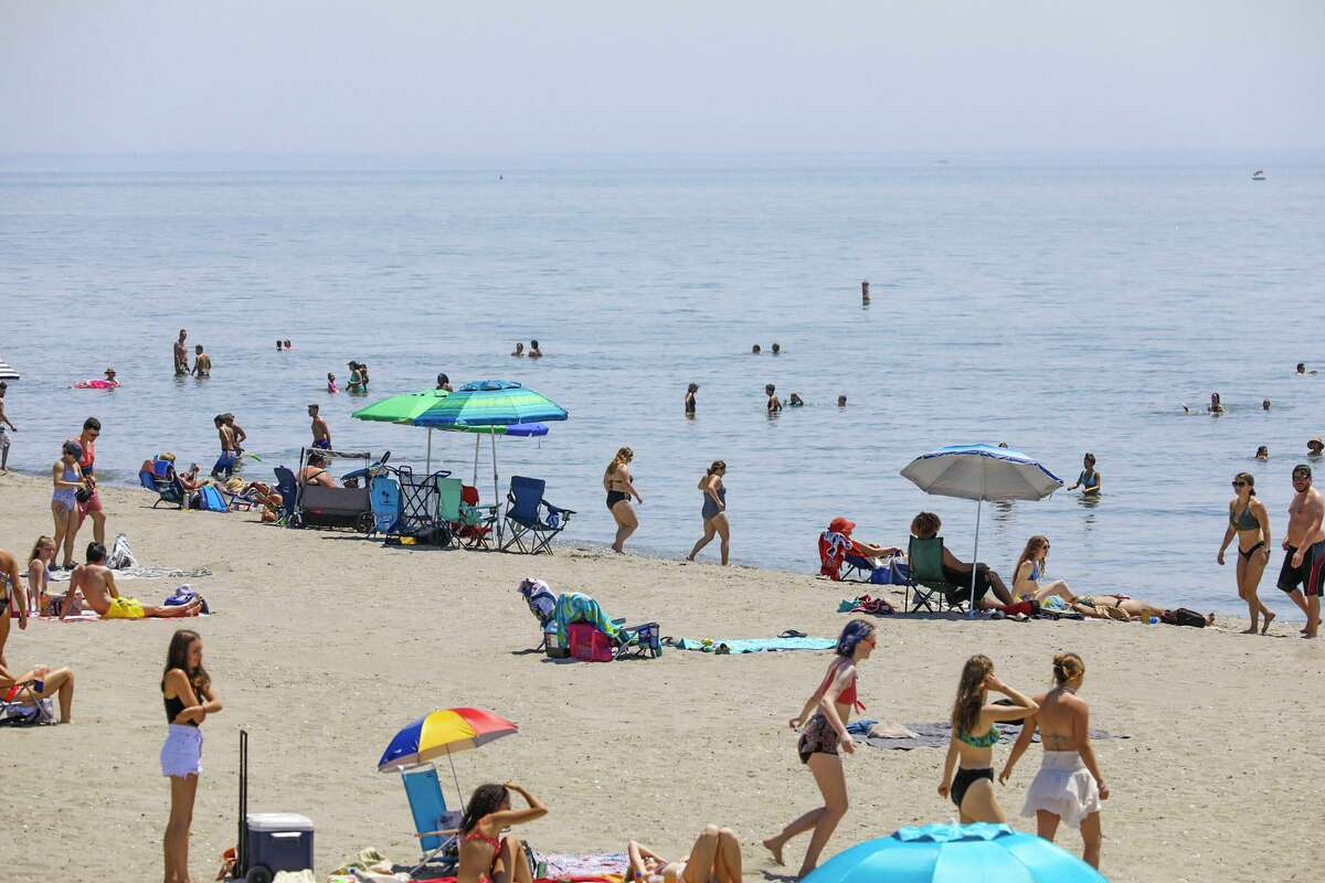 Crowds gathered Tuesday at Hammonasset Beach State Park in Madison as temperatures again rose into the 90s.