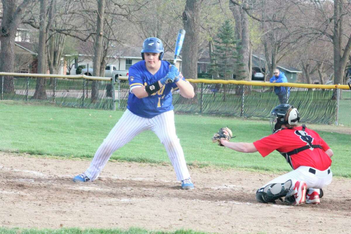 Mac Sims holds off on a pitch against Big Rapids earlier this season. (Pioneer file photo)