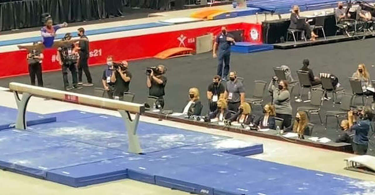 Auxiliary judges Judy Johnson-Durr and Posy Durr, at table far right, watch competitor Simone Biles, far left, during the balance beam competition at the US Gymnastics Trials last week in St. Louis.
