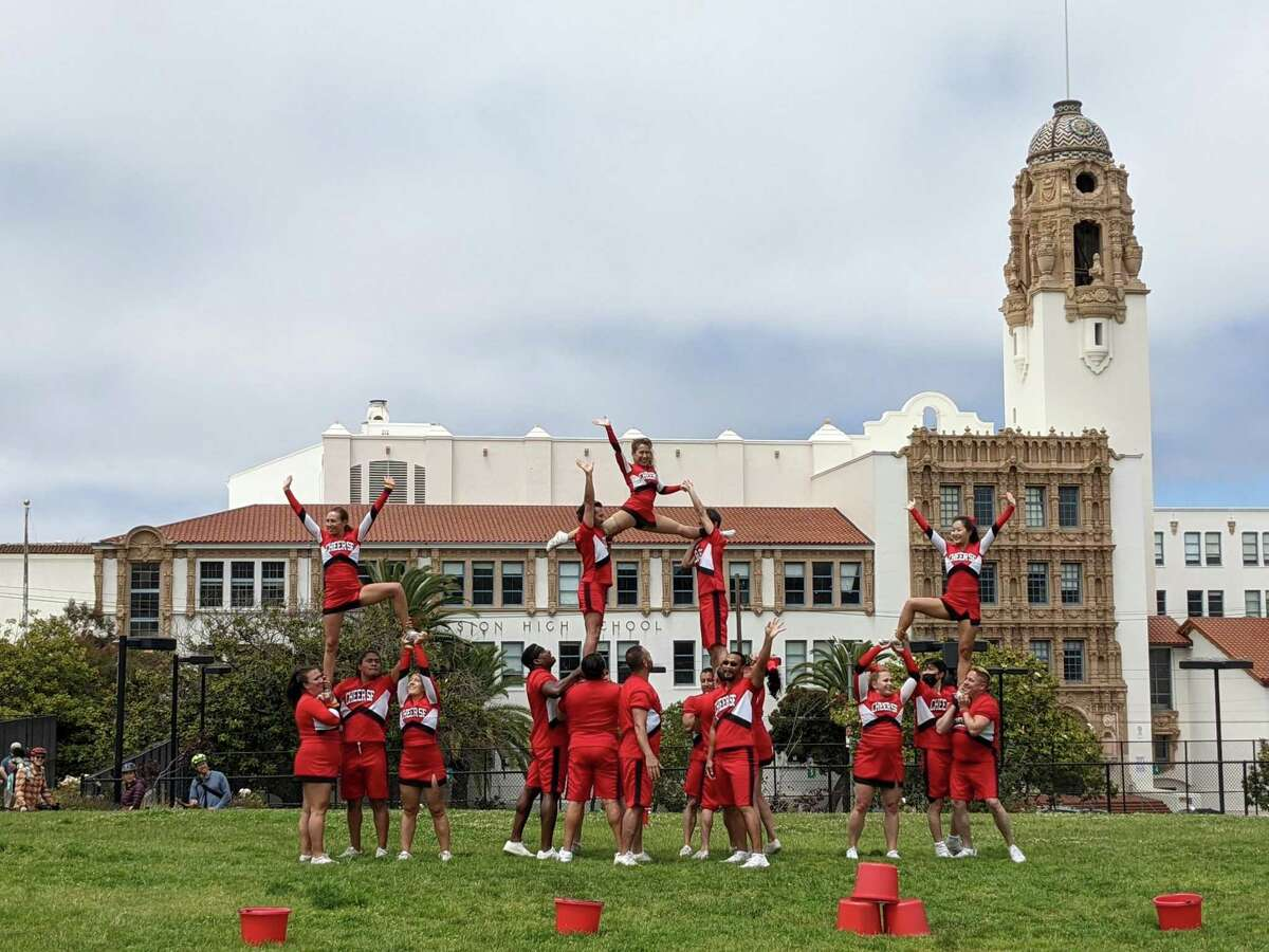 Cheer S.F. performing an anti-litter routine at Dolores PArk during Pride.
