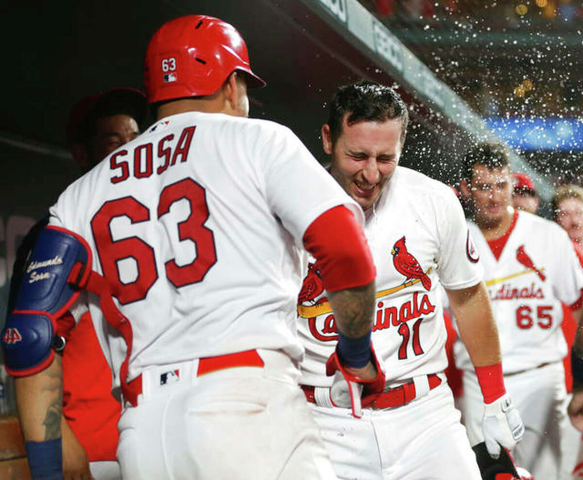 St. Louis Cardinals' Paul DeJong (11) is doused by teammate Edmundo Sosa after hitting a two-run home run in the seventh inning Monday against the Arizona Diamondbacks in St. Louis.