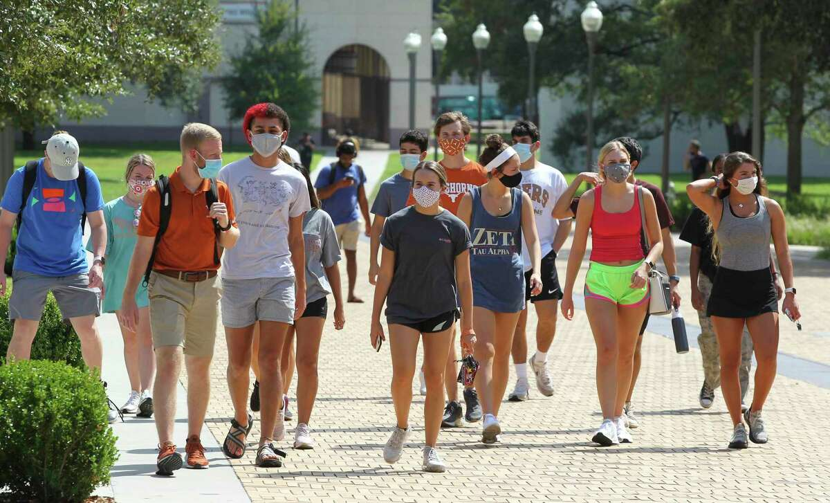 University of Texas students walk on campus to and from classes. Gov. Greg Abbott is allocating $94.6 million in federal COVID-19 relief money for higher education programs to support students as they continue to navigate college during the pandemic.