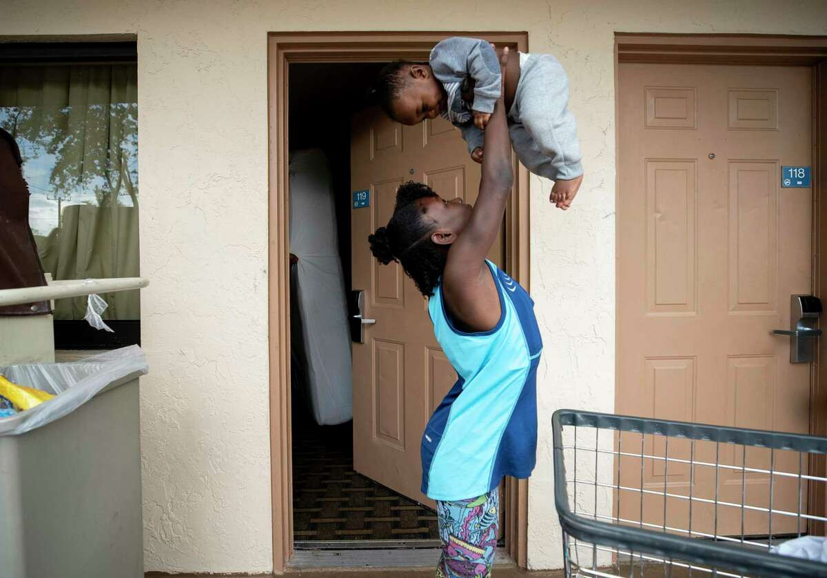 Jermaira plays with her 11-month-old brother, Ahmere, as housekeeping cleans the rooms her family is living in two weeks after being evicted from their Stonybrook apartment, on Saturday, Feb. 15, 2020, in West Palm Beach, Fla.