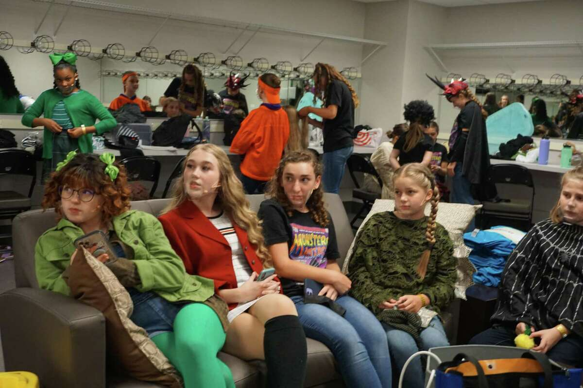 Students from Inspiration Stage hang out in their dressing room before performing The Big One-Oh! JR. at the 2021 Junior Theater Festival Texas on Saturday, June 26, at Smart Financial Centre in Sugar Land.