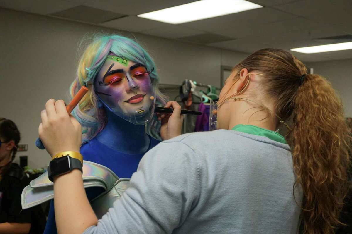Jane Delahoussaye from Inspiration Stage receives last-minute touch-ups before performing in The Big One-Oh! JR. at the 2021 Junior Theater Festival Texas on Saturday, June 26, at Smart Financial Centre in Sugar Land.