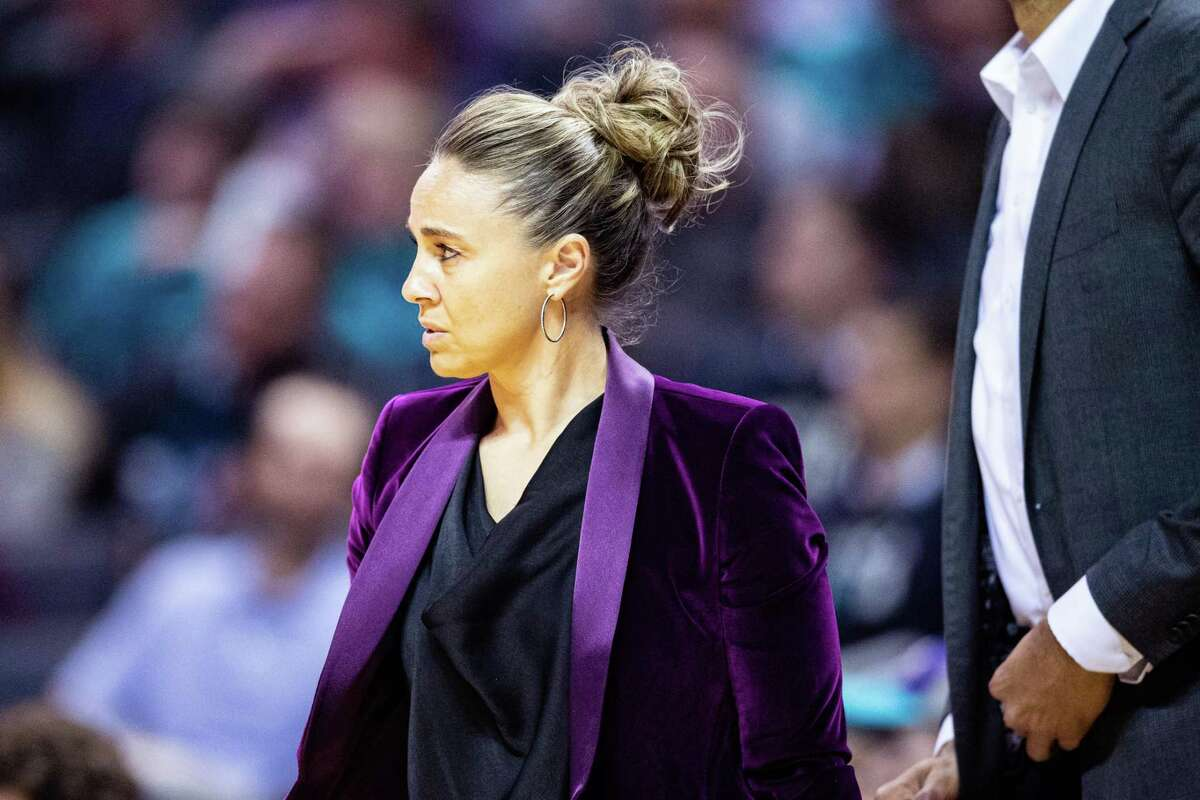 Becky Hammon of the San Antonio Spurs during the first quarter during their game against the Charlotte Hornets at Spectrum Center on March 03, 2020 in Charlotte, N.C.
