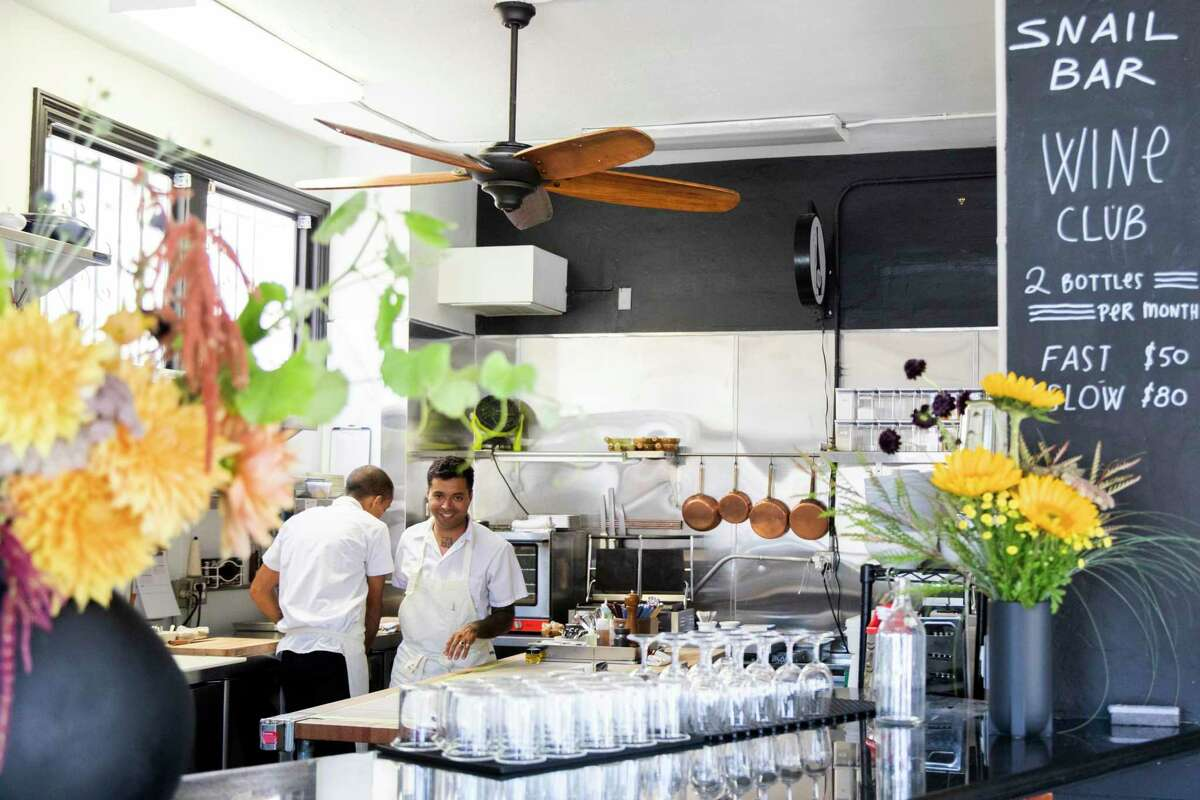 Owner Andres Geraldo Florez works in the kitchen of Snail Bar in Oakland, which opens July 3.