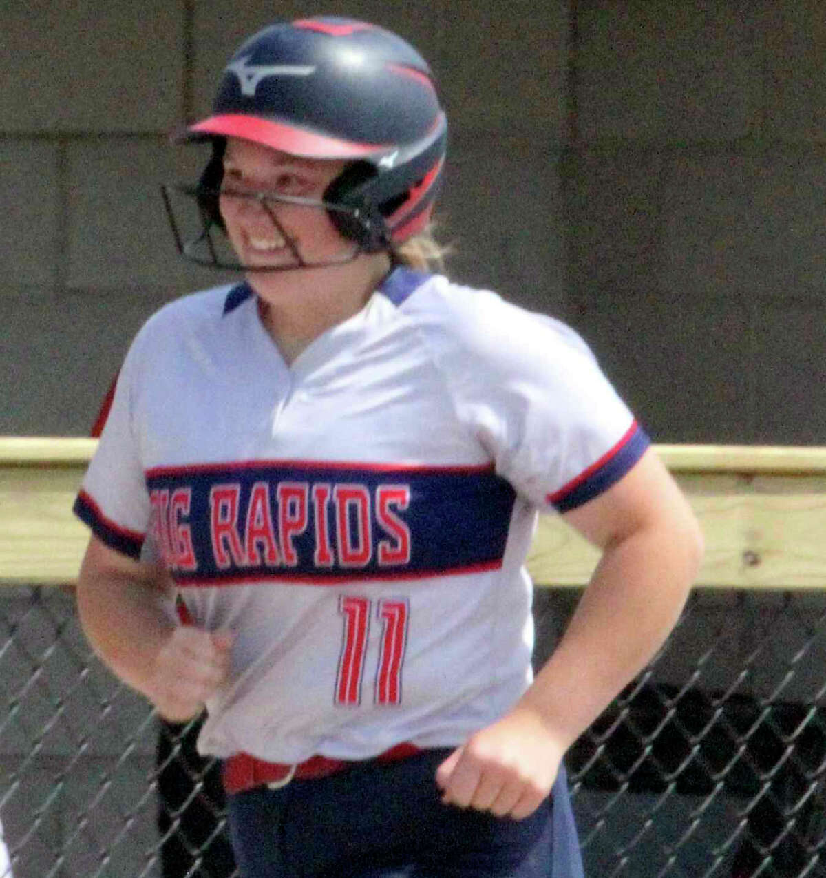 Jaylynn Gray flashed her home run smile for Big Rapids while rounding the bases in the regional semifinal at Cadillac.