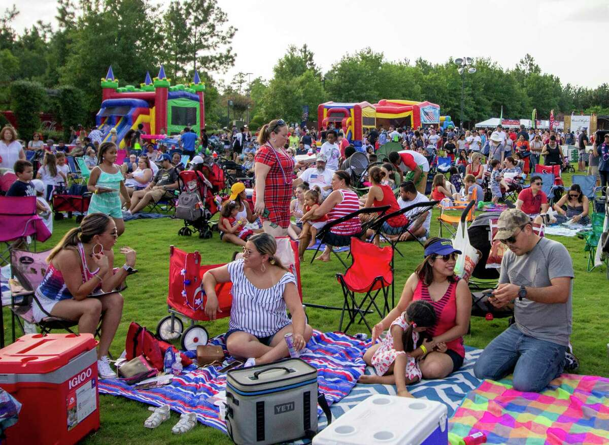 Crowds pick out spots to watch fireworks later in the evening during the the 22nd annual Red, Hot and Blue festival July, 4, 2019 at Town Green Park in The Woodlands. This year's festival will take place in several parks across The Woodlands.