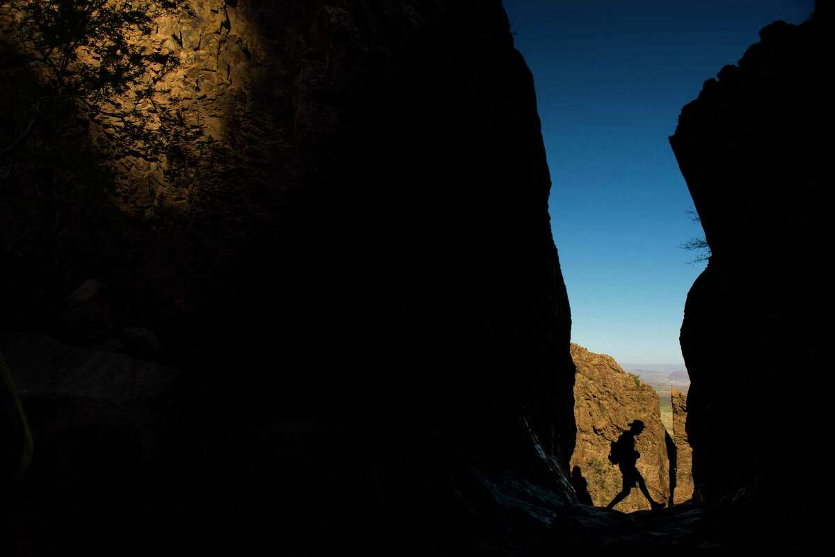 A hiker checks out the view from The Window in Big Bend National Park Sunday, April 9, 2017. ( Michael Ciaglo / Houston Chronicle)