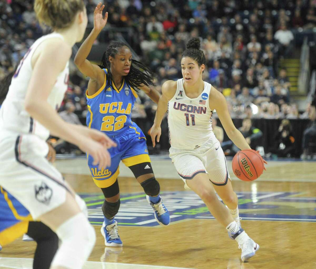 UConn's Kia Nurse (11) drives past UCLA's Kennedy Burke (22) in No. 1 UConn's 86-71 win over No. 4 UCLA in the 2017 NCAA Division I Women's Basketball Championship Regional Semifinal game at Webster Bank Arena in Bridgeport, Conn. Saturday, March 25, 2017.