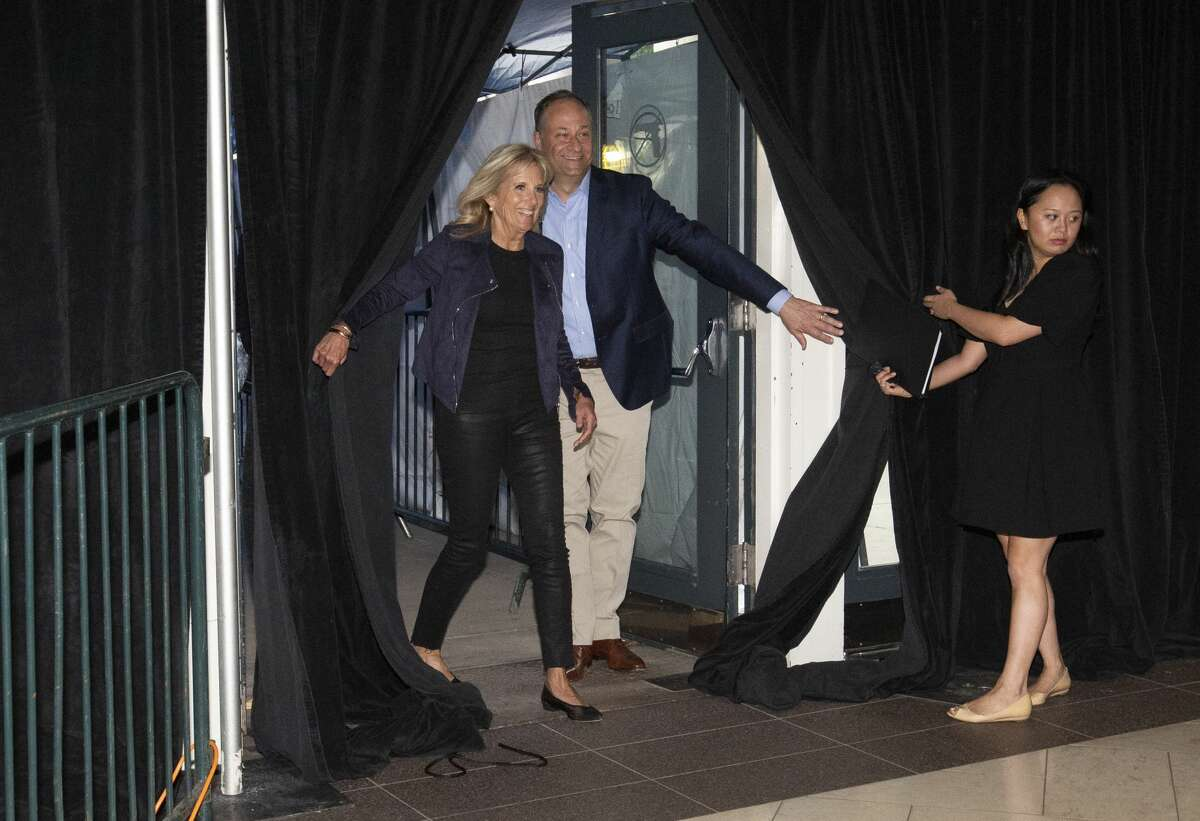 First Lady Jill Biden and Second Gentleman Douglas Emhoff arrive the Houston Astros' vaccination event Tuesday, June 29, 2021, at Minute Maid Park in Houston. The Astros, in partnership with Houston Methodist, hosts free COVID-19 vaccinations to the public on Tuesday.