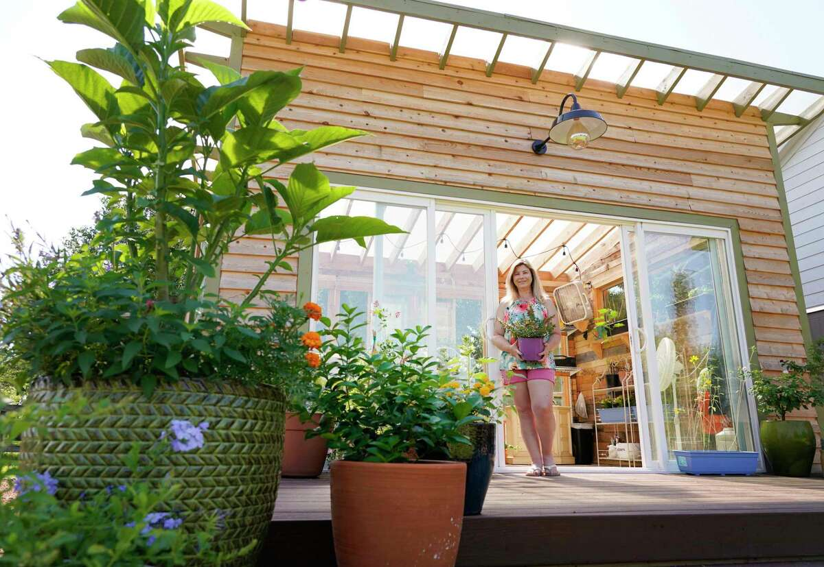 The greenhouse has big sliding-glass doors that lead out to a small deck.