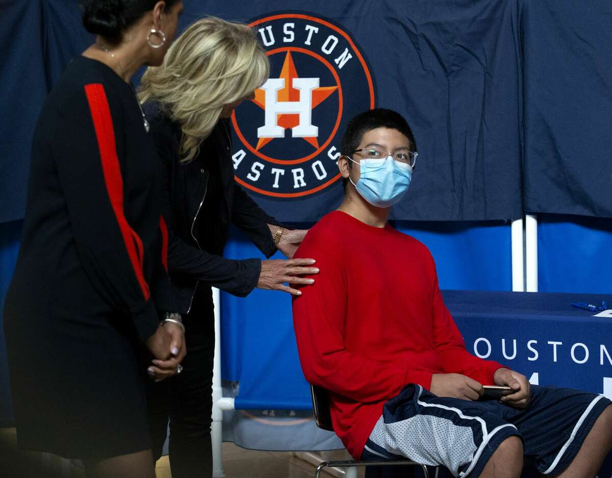 First Lady Jill Biden, who is visiting and touring the Houston Astros' vaccination event, says good-bye to Jose Cabos, a COVID-19 vaccination participant, Tuesday, June 29, 2021, at Minute Maid Park in Houston. The Astros, in partnership with Houston Methodist, hosted free vaccinations to the public.