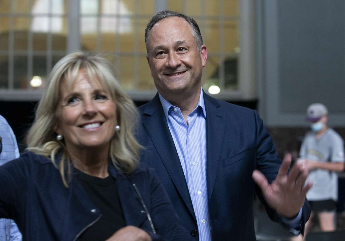 First lady Jill Biden and second gentleman Douglas Emhoff wave at the media after a tour at a Houston Astros' COVID-19 vaccination event, Tuesday, June 29, 2021, at Minute Maid Park in Houston. (Yi-Chin Lee/Houston Chronicle via AP)
