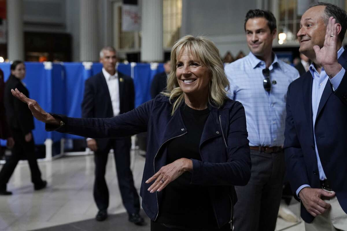 First lady Jill Biden and Doug Emhoff, husband of Vice President Kamala Harris, right, visit a vaccination event at Minute Maid Park, in Houston, Tuesday, June 29, 2021. (AP Photo/Carolyn Kaster, Pool)