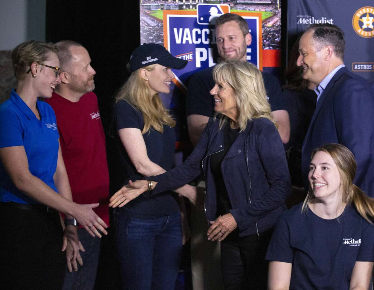 First Lady Jill Biden and Second Gentleman Douglas Emhoff shake hands with Houston Methodist employees at a partnership vaccination event between the hospital and the Houston Astros Tuesday, June 29, 2021, at Minute Maid Park in Houston. The Astros, in partnership with Houston Methodist, hosted free COVID-19 vaccinations to the public on Tuesday.