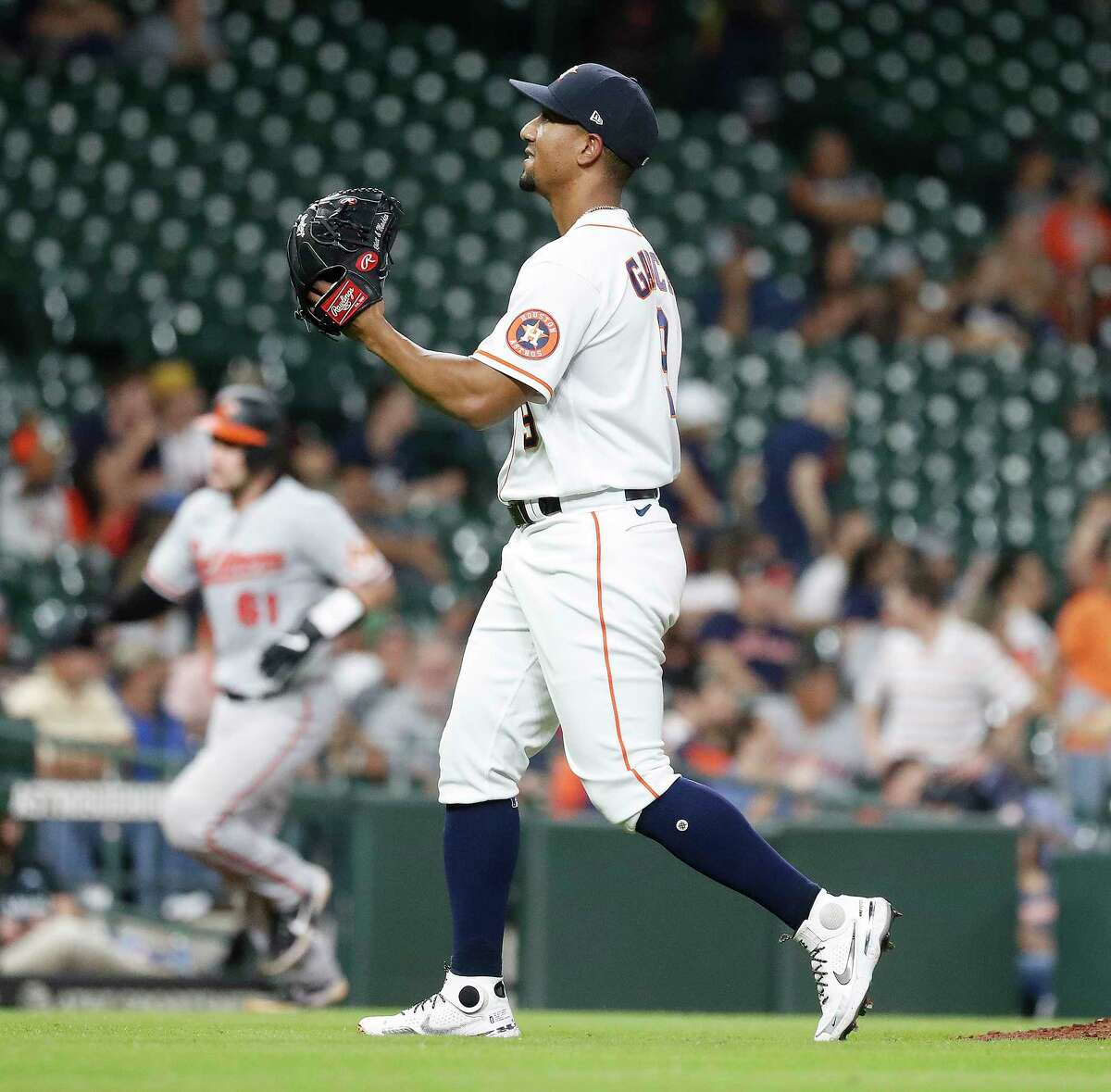 Houston Astros infielder Robel Garcia (9) reacts after giving up a home run to Baltimore Orioles catcher Austin Wynns as he pitched during the ninth inning of an MLB baseball game at Minute Maid Park, Tuesday, June 29, 2021, in Houston.